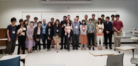 Group photo from the AMS meeting in a classroom in Honolulu, Hawaii.