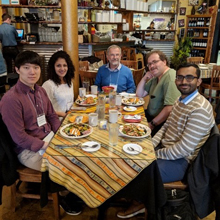 Seung Yeop Yang, Rhea Palak Bakshi, Jozef Przytycki, Alex Shumakovitch, and Sujoy Mukherjee gathered around a table.