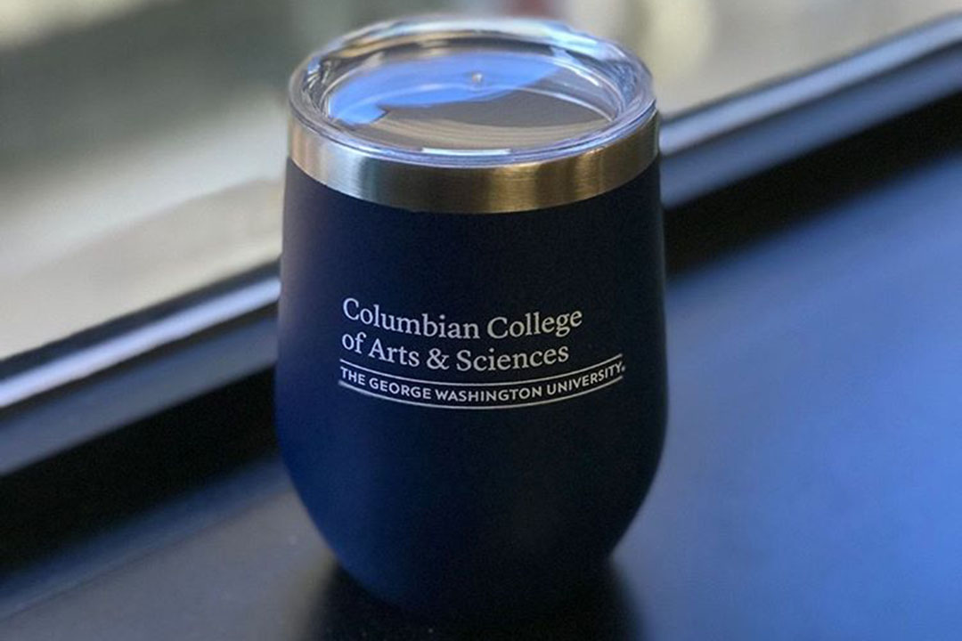"A coffee tumbler mug showing the words ""Columbian College of Arts and Sciences, The George Washington University"""