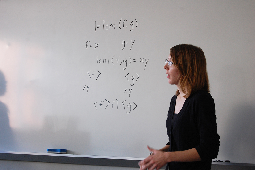 A Woman in Math student explaining a formula